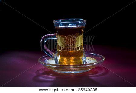 A classic arabic tea cup on dark background