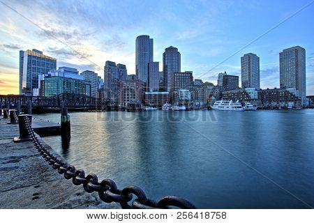 Boston Skyline With Financial District And Boston Harbor At Sunset