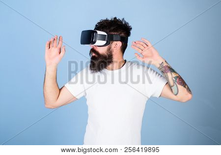 Hipster On Busy Face Exploring Virtual Reality With Modern Gadget. Vr Gadget Concept. Guy With Head