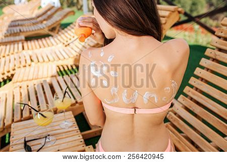 Well-built And Slim Girl Sits On Sunbed And Shows Her Back. It Is Covered With White Spots. Girl Loo