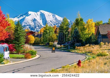 Slow children at play street sign at residential neighborhood in Colorado at autumn, USA. Mount Sopris landscape.