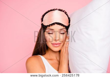 Portrait Of Young Gorgeous Smiling Lady Wearing Eye Mask, Happily Sleeping On Pillow. Isolated Over