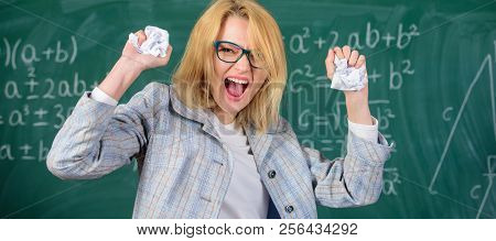 Trial And Error Is Fundamental Method Of Problem Solving. Woman Teacher Holds Crumpled Pieces Of Pap