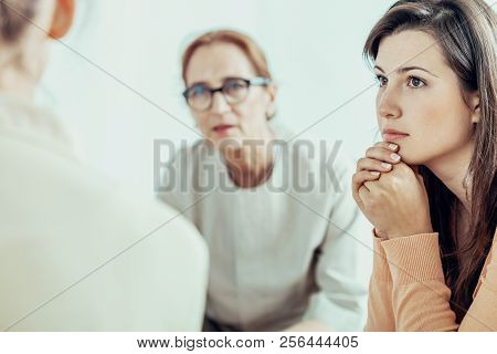 Woman Listening To Therapist During Training For Businesswoman In The Office