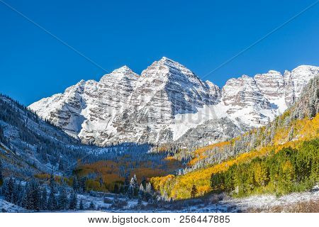 Close Up Maroon Bells Peaks With Yellow Aspen Forest In Colorado