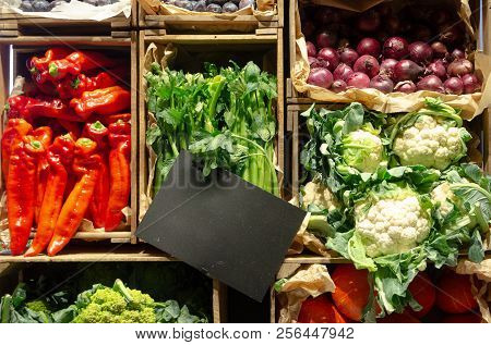 Fresh Vegetables In Wooden Crate With Empty Price Tag, Market Display