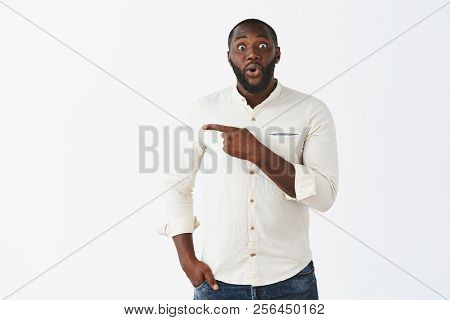 Hurry Up And Look That Way. Impressed, Amazed Handsome African American Boyfriend In White Stylish S