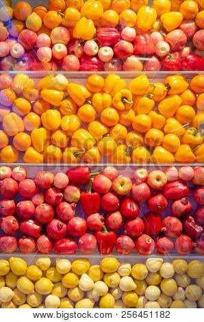 Various Yellow And Red Fruits Wall Background