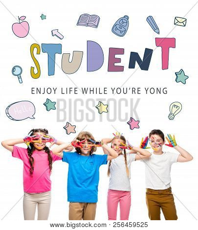 schoolchildren having fun and showing painted hands with smiley icons isolated on white, with student - enjoy life while youre yong lettering poster