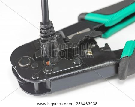 Crimping tool for twisted pair on white background poster