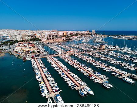 Aerial Panoramic View Of Torrevieja Cityscape And Marina Port. Nautical Vessel, Yachts, Motoboats Mo