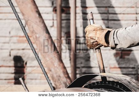 Worker Hand Pulling The Lever Of A Pile Driver (bate-estaca). Construction Worker. Hand Holding A Le