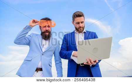 Businessman With Laptop Serious While Business Partner Ridiculous Glasses Looks Funny. Unprofessiona