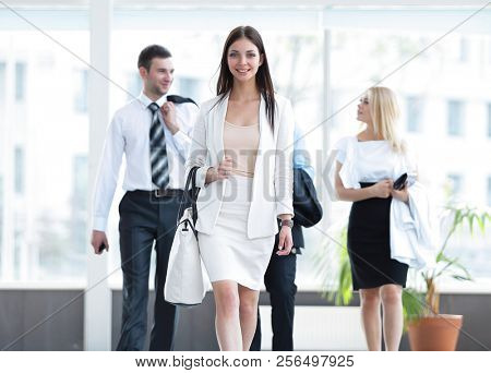modern business woman walking in the spacious lobby