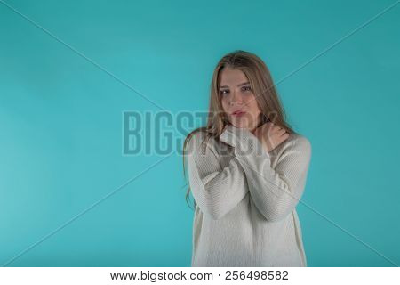 Pretty Female With Long Hair, Dressed Casually In Ivory Sweater, Looking With Satisfaction At Camera