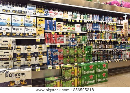 Various Selection Of Mexican Imported Beer Bottles At Supermarket