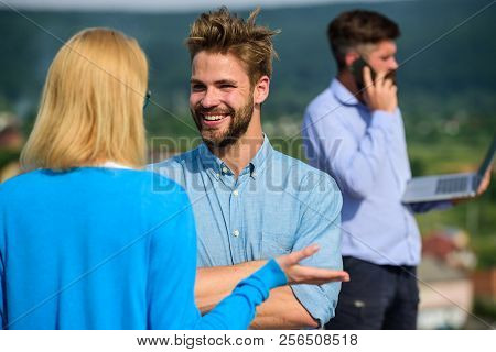 Couple Having Fun While Busy Businessman Speak On Phone. Couple Happy Flirting While Man Tense With