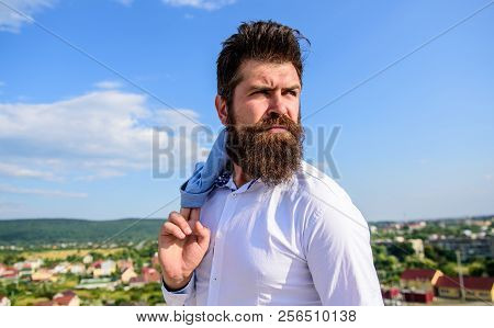 Guy reached top but feel frustrated. Motivation and ambitions concept. Hipster beard mustache looks puzzled frustrated. Frustration feeling. Man bearded hipster formal style look back sky background poster