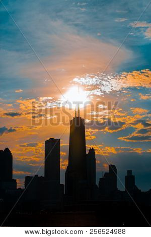 Silhouette Of Chicago Skyline Viewed From The Pier With Orange And Blue Sunset Sky In The Background