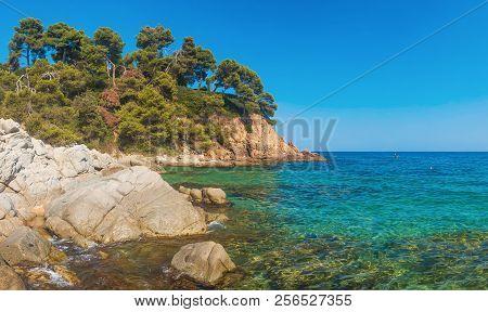 Seascape Of Rocks And Stones In Sea On Cala Sa Boadella Platja Beach In Lloret De Mar Of Costa Brava
