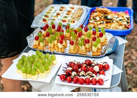 Buffet Assortment Of Canapes. Banquet Service. Catering Food, Snacks With Mixed Fingerfood Appetizer