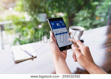 Chiang Mai, Thailand - August 18,2018: Woman Hands Holding Huawei With Facebook App On The Screen. F