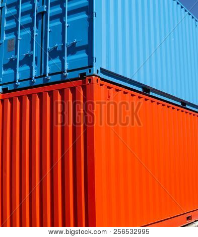 Two disused cargo containers paint in bright colors stacked poster