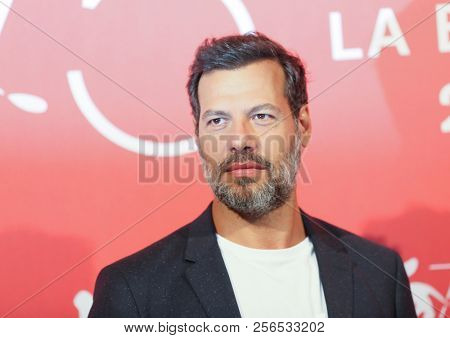 Laurent Lafitte attends 'L'Heure De La Sortie' photocall during the 75th Venice Film Festival at Sala Casino on August 31, 2018 in Venice, Italy.