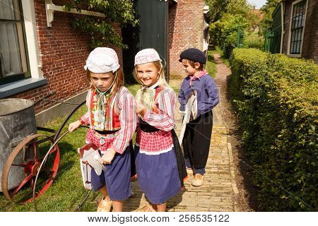 Enkhuizen, Netherlands - August 19, 2015 - The Unidentified Children In The Traditional National Clo