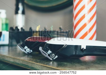 Hair Clippers And Shaving Accessories And Tools Of Barber Shop On A Wooden Desk
