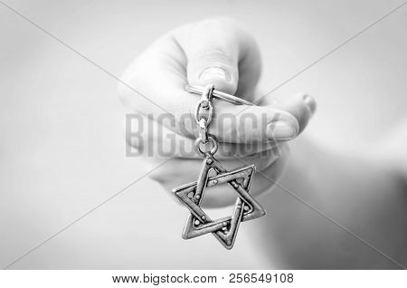 A Hand Of A Young Woman Holding A Star Of David Key Chain. The State Of Israel, Judaism, Zionism Or