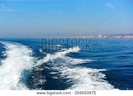 Wavy Trail On The Mediterranean Sea After Vessel, Ship, Ferry Speed Floating. Tourist Ferry In The S
