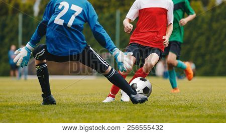 Football Action. Boys Kicking Football Match On Field. Children Soccer Game At School Pitch. Kids Pl