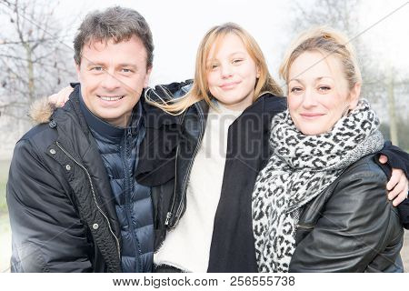 Cheerful Winter Family With Pretty Blonde Daughter Cute Mother And Handsome Father