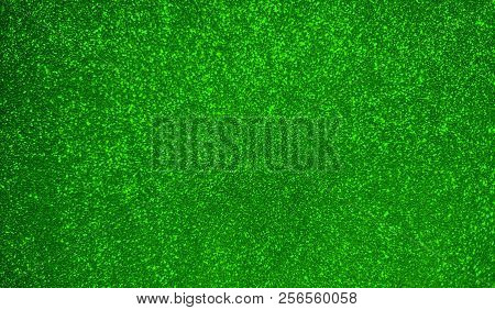 Beautiful Abstract Green Bokeh Background. Holiday Green Texture. Glitter Christmas Paper For Design