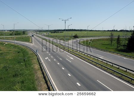 Image of lanes of asphaltic motorway.