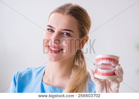 Young doctor nurse with dentures