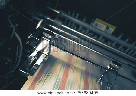 Printing Press With Blurred Belt During Printing Process.