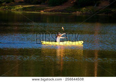 September 2, 2018 In Jenks Lake, Ca:  Person Kayaking With A Paddle Taken At Jenks Lake, Ca Where Pe