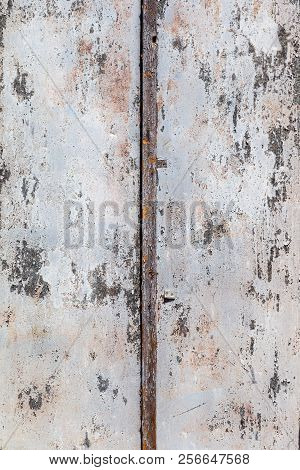 Wooden conceptual background. Old painted background of wooden boards. Traces of an old cracked peel