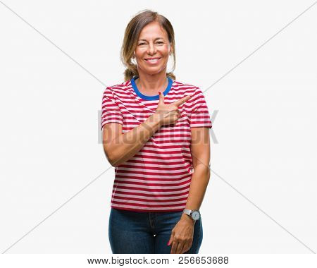 Middle age senior hispanic woman over isolated background cheerful with a smile of face pointing with hand and finger up to the side with happy and natural expression on face looking at the camera.