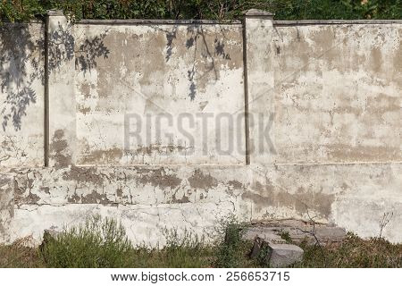 An Old Stone Plastered Cement Wall As A Background For Any Design. Texture Of A Plastered Stone Wall