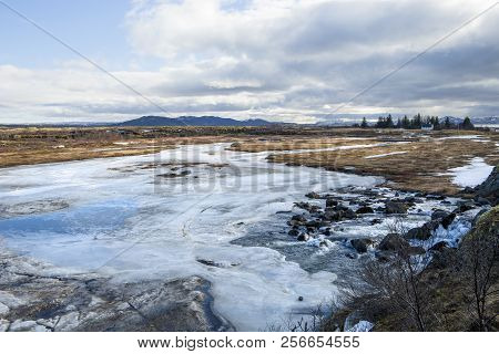 Looking Out At The Frozen River At Thingvellir National Park In Iceland
