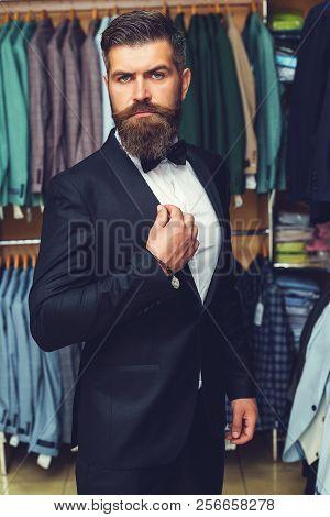 Handsome Bearded Man In Black Tuxedo. Tailor, Tailoring. Men's Suit, Tailor In His Workshop. Elegant