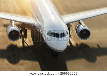 Detail of commercial jetliner forcing on runway. Motion blur effect added. Shot from high angle