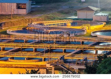 Modern industrial wastewater treatment plant at night. Aerial view of sewage purification tanks. poster