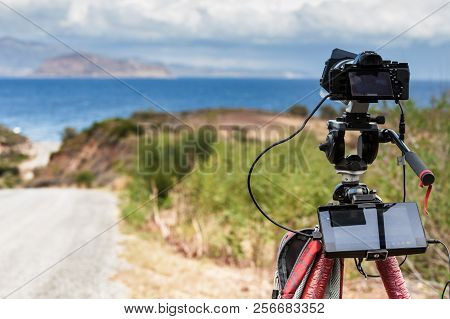 Professional Camera Taking Film Video Or Shooting Images Pictures Of Sea Coastline In Greece Pelopon