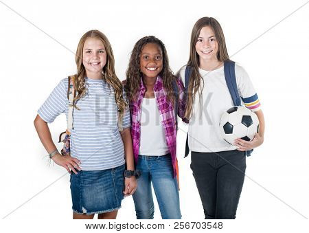 Smiling group of cute teenage junior high school students. Diverse girls are also soccer teammates and happy to be together