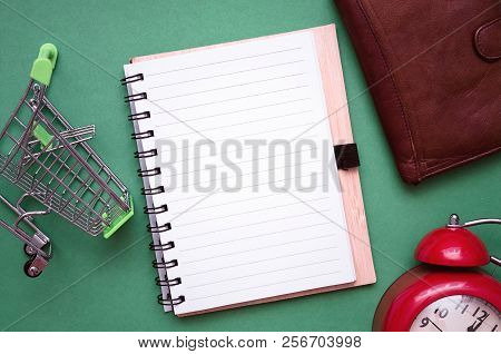 Shopping Cart, Wallet, Red Alarm Clock And Shopping List Isolated On Color Background. Time To Shop.