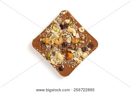 Milk Chocolate Bar With Hazelnuts, Pistachio And Cashew Isolated On White Background. Luxury Handmad